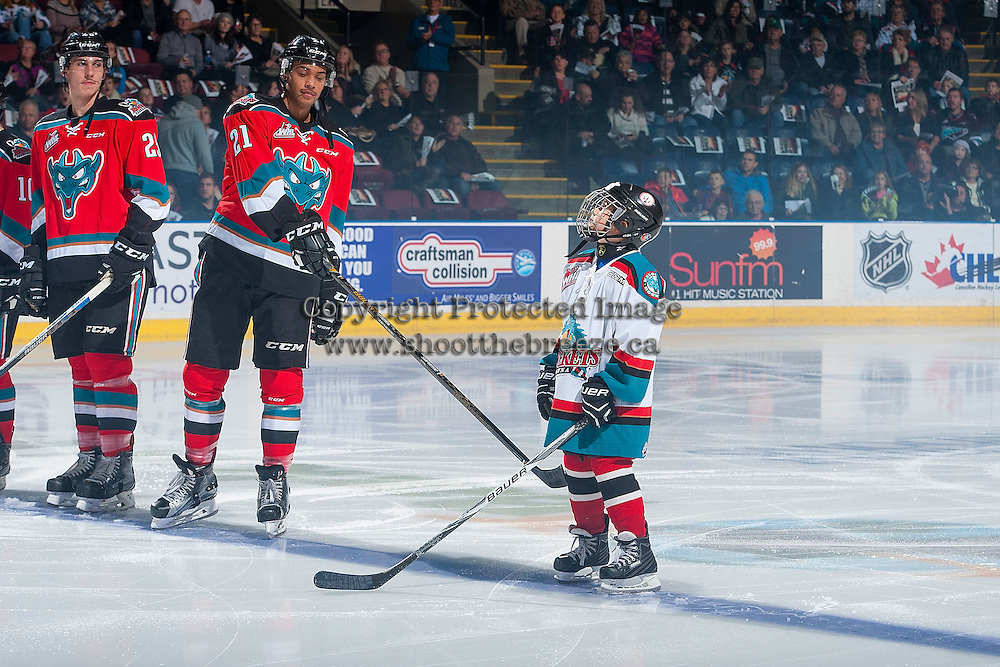 KELOWNA, CANADA - NOVEMBER 26: Devante Stephens #21 of the Kelowna Rockets congratulates the Pepsi Save On Foods Player of the game against the Regina Patson November 26, 2016 at Prospera Place in Kelowna, British Columbia, Canada.  (Photo by Marissa Baecker/Shoot the Breeze)  *** Local Caption ***
