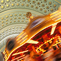 Penn Sation in Washington DC coming alive with an indoor Merry-go-round rotating with a colorful red swirl.