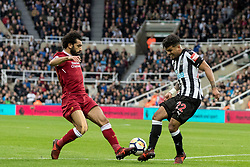 NEWCASTLE-UPON-TYNE, ENGLAND - Sunday, October 1, 2017: Liverpool's Mohamed Salah and Newcastle United's DeAndre Yedelin during the FA Premier League match between Newcastle United and Liverpool at St. James' Park. (Pic by Paul Greenwood/Propaganda)