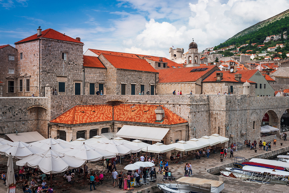 The city wall and red tile roofs above the harbor, Dubrovnik, Dalmatian Coast, Croatia