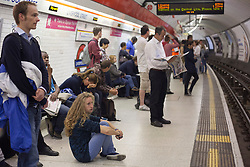 © licensed to London News Pictures. London, UK 31/07/2012. People waiting a Central Line train anxiously to Stratford (Olympic Park) as their train terminated at Liverpool Street Station. The line operated with severe delays and temporarily lost its connection to Stratford (Olympic Park) on 31/07/12. Photo credit: Tolga Akmen/LNP