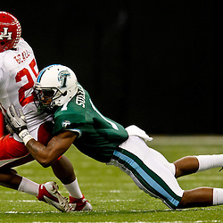 November 10, 2011; New Orleans, LA, USA; Tulane Green Wave cornerback Jordan Sullen (1) tackles Houston Cougars running back Bryce Beall (25) during the second quarter at the Mercedes-Benz Superdome.  Mandatory Credit: Derick E. Hingle-US PRESSWIRE