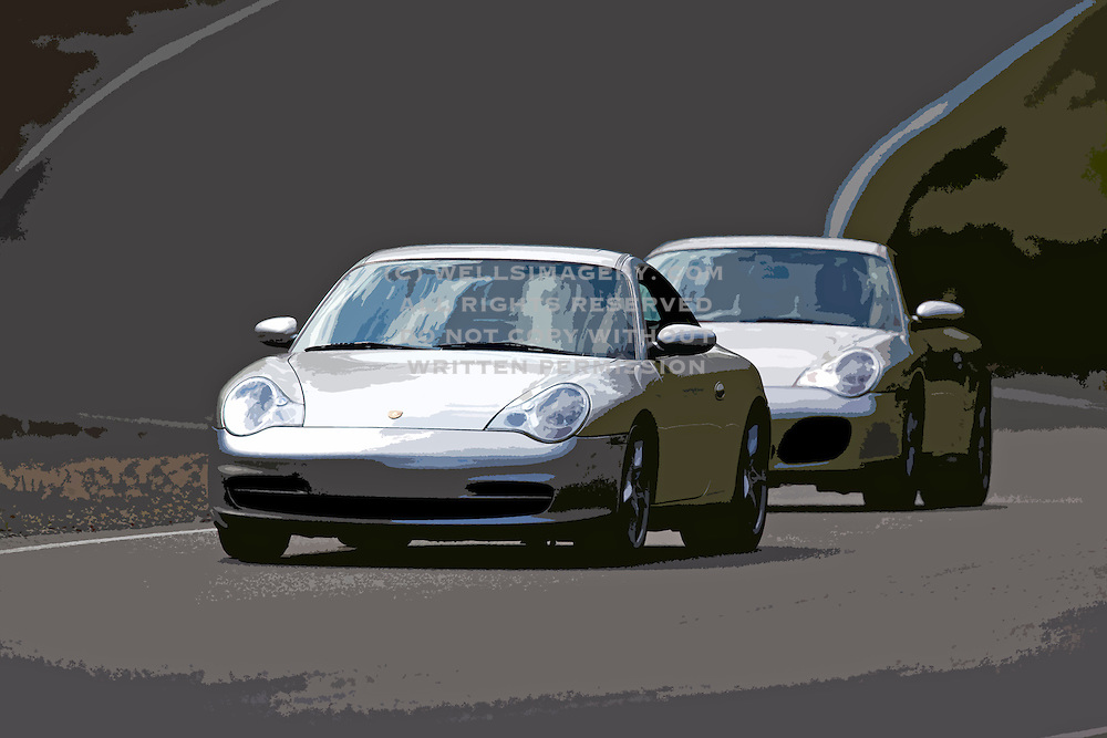 Image of two silver Porsches on a racetrack