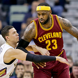 Dec 12, 2014; New Orleans, LA, USA; Cleveland Cavaliers forward LeBron James (23) is guarded by New Orleans Pelicans guard Austin Rivers (25) during the first quarter of a game at the Smoothie King Center. Mandatory Credit: Derick E. Hingle-USA TODAY Sports
