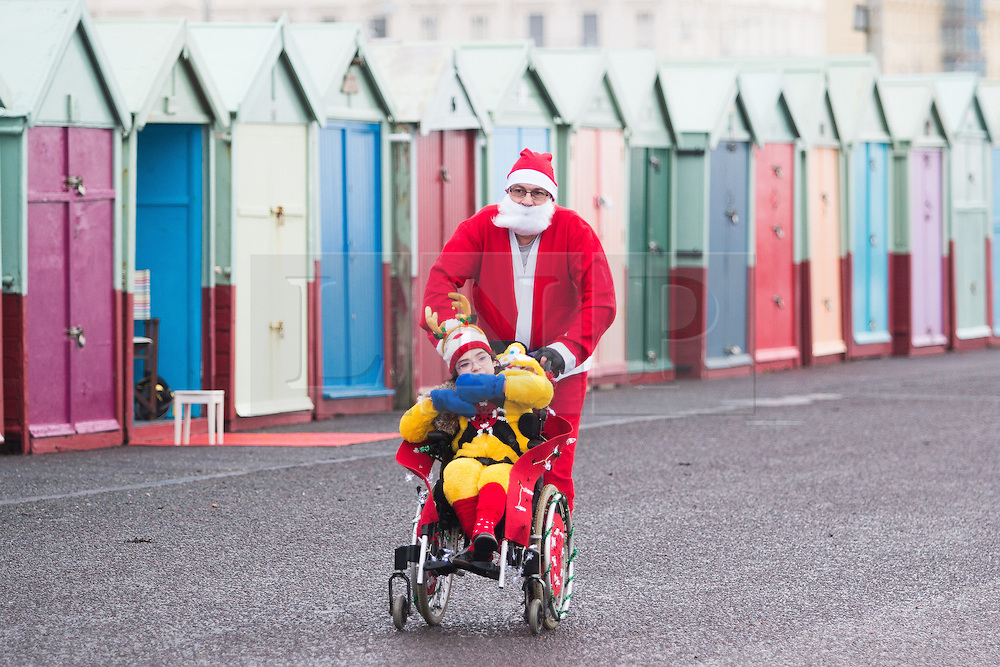 © Licensed to London News Pictures. 12/12//2015. Brighton, UK. thousands of runners dressed as Santa Claus take part in the yearly Brighton Santa Dash in aid of Brighton's Chrildren's Charity Rockinghorse. Today December 12th 2015. Photo credit: Hugo Michiels/LNP