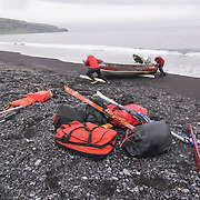 After off-loading our gear we used pvc pipe to push and drag the skiff above the high water line on the beach.