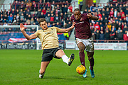 Ash Taylor (#14) of Aberdeen FC tackles Uche Ikpeazu (#19) of Heart of Midlothian FC during the Ladbrokes Scottish Premiership match between Heart of Midlothian FC and Aberdeen FC at Tynecastle Stadium, Edinburgh, Scotland on 29 December 2019.