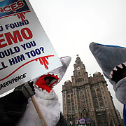 Greenpeace campaigners dressed as sharks and with the sound track from .Jaws. protest outside The Liver Building in Liverpool, head office of Princes, the biggest tinned tuna company in the UK. They handed leaflets to Princes staff as they arrived at work.