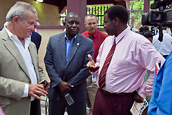 Mr. Kurt Lewis talks to Lt. Gov. Francis, Mr. Stephen Evans-Freke, and Dr. Peter Corr about the details of the Tilapia Farm.