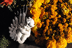A sleeping cherub is surrounded by marigolds at Queen of Heaven Cemetery. In a touching final celebration of All Soul's Day on Saturday night, hundreds of congregants came to the hilltop in Salinas to attend mass, offer their prayers, and as dusk fell, participate in a candlelight procession.  Friends and family members sat by the graves of loved ones, many of which were decorated with traditional Day of the Dead flowers, photographs of the departed, and things that were their favorites in life.