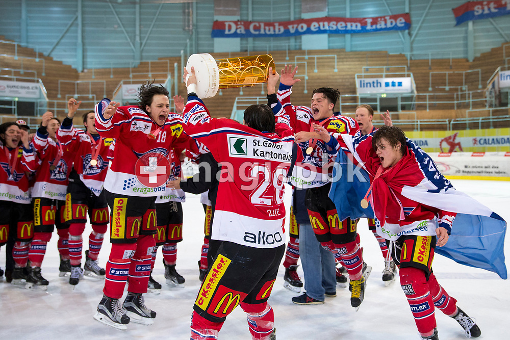 Rapperswil-Jona Lakers players celebrate with the Swiss champion trophy after winning the fifth Elite B Playoff Final ice hockey game between Rapperswil-Jona Lakers and ZSC Lions held at the SGKB Arena in Rapperswil, Switzerland, Sunday, Mar. 19, 2017. (Photo by Patrick B. Kraemer / MAGICPBK)