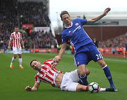 Phillip Bardsley of Stoke City (L) tackles Nemanja Matic of Chelsea - Mandatory by-line: Jack Phillips/JMP - 18/03/2017 - FOOTBALL - Bet365 Stadium - Stoke-on-Trent, England - Stoke City v Chelsea - Premier League