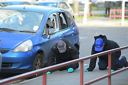 © Licensed to London News Pictures 17/01/2018 London UK. Police examine the scene in Biggerstaff Road, Stratford, east London where a man was shot last night. Photo credit: Steve Poston/LNP