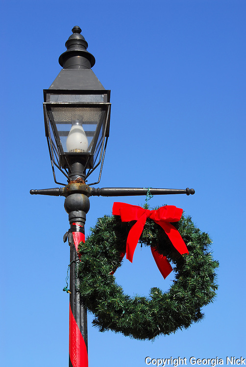 Florida Holiday Decorations - Light Post and Wreath against a beautiful blue sky.