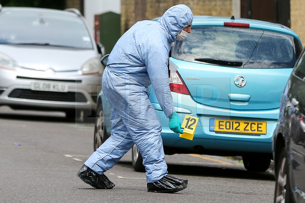 © Licensed to London News Pictures. 28/05/2019. London, UK. A forensic officer places a marker on Dyson Road, Forest Gate, East London where a man in his 30s died in the early hours of this morning following a flight on Warwick Road.<br /> Police officers were called after the victim was found suffering from stab injuries and he died later in the hospital. Photo credit: Dinendra Haria/LNP CAPTION UPDATED WITH CORRECT DATE