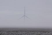Wind turbines rise above the winter landscape near the Columbia River Gorge, Oregon.