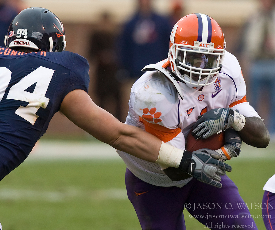 Clemson running back James Davis (1) takes on Virginia defensive end Matt Conrath (94).  The Clemson Tigers defeated the Virginia Cavaliers 13-3 in NCAA Division 1 football at Scott Stadium on the Grounds of the University of Virginia in Charlottesville, VA on November 22, 2008.