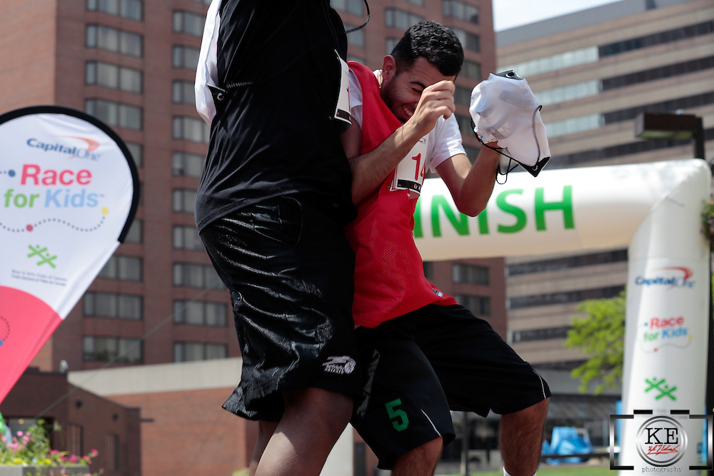 Two players from friendly teams celebrate finishing the #RFK2013 run with a victory bump.