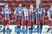 Scunthorpe United celebrate Luke Williams of Scunthorpe United scoring to go 1-0 up   during the Sky Bet League 1 match between Scunthorpe United and Bury at Glanford Park, Scunthorpe, England on 19 April 2016. Photo by Ian Lyall.