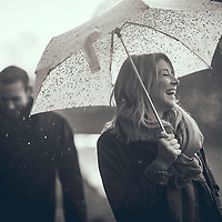 Young adult couple outdoors in the rain