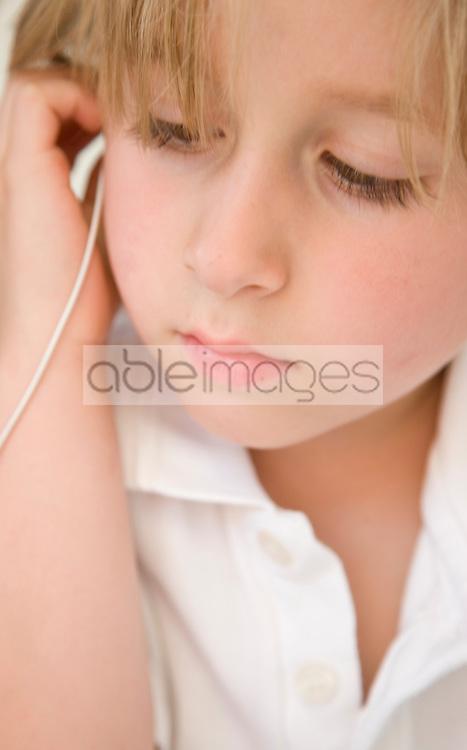 Boy Wearing Earphones