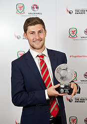 CARDIFF, WALES - Monday, October 6, 2014: Wales' Young Player of the Year Ben Davies with his award at the FAW Footballer of the Year Awards 2014 held at the St. David's Hotel. (Pic by David Rawcliffe/Propaganda)