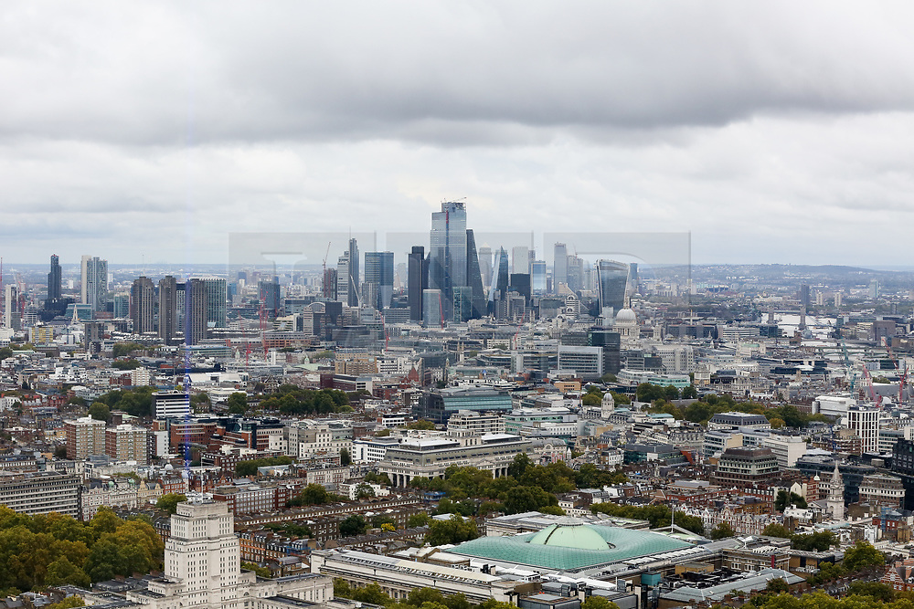 © Licensed to London News Pictures. 22/09/2019. London, UK. An aerial view of London showing dark rain clouds over London financial district, Sent House, St Pauls Cathedral and British Museum seen from BT Tower. Photo credit: Dinendra Haria/LNP