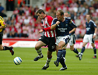 Photo. Chris Ratcliffe. <br /> Southampton v Newcastle United. Barclays Premiership. 19/09/2004<br /> Rory Delap of Southampton clashes with Alan Shearer of Newcastle<br /> NORWAY ONLY