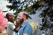 Reed Swaggerty-Morgan (left) plays with father Chuck Swaggerty-Morgan's beard April 26, 2015, as they spend time together at their home in Sioux City, Iowa.