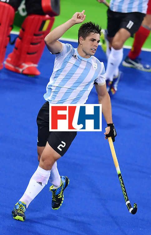 Argentina's Gonzalo Peillat celebrates after scoring a goal during the men's Gold medal field hockey Belgium vs Argentina match of the Rio 2016 Olympics Games at the Olympic Hockey Centre in Rio de Janeiro on August 18, 2016. / AFP / MANAN VATSYAYANA        (Photo credit should read MANAN VATSYAYANA/AFP/Getty Images)