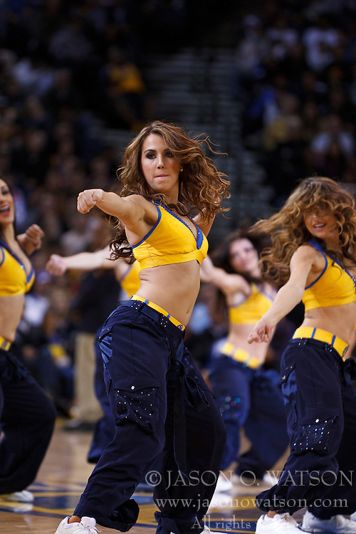 Mar 28, 2012; Oakland, CA, USA; Golden State Warriors cheerleaders perform during the third quarter against the New Orleans Hornets at Oracle Arena. New Orleans defeated Golden State 102-87. Mandatory Credit: Jason O. Watson-US PRESSWIRE