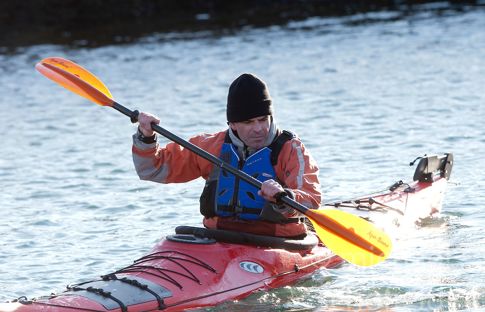 Scottish Sun sports editor Iain King takes part in a practise session for his charity kayak challenge, in the waters of the harbour at St Abbs..Pic © Michael Schofield...