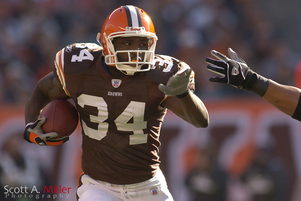 Cleveland Browns running back #34 Reuben Droughns heads up filed on a 75-yard touchdown run in the first quarter against the Miami Dolphins at Cleveland Browns Stadium on Nov. 20, 2005 in Cleveland, Ohio.        ..©2005 Scott A. Miller