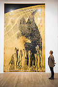 Fear,  Black Man - Alibis a Sigmar Polke retrospective at the Tate Modern – he was viewed as one of the most experimental artists of recent times and the exhibition covers his full career, bringing together works from around the world in a huge variety of materials. Highlights include: Girlfriends – An iconic early Pop painting from 1965 of a bikini-clad girl; Potato House – Standing over 6 feet tall, this sculpture of a house is made from wooden lattices covered in real potatoes; Mao – A huge felt banner covered in scraps of cloth and painted with an image of Chairman Mao; Watchtowers – A series of neon-coloured paintings incorporating silver, resin, fabric and bubble-wrap; and other paintings made from such diverse materials as meteorite dust, soot, lead, coal, elastic bands and medical tape. The exhibition runs from 9 October 2014 – 8 February 2015.  Tate Modern, Bankside, London, UK 07 Oct 2014.