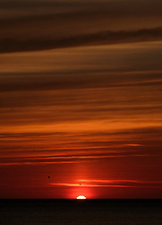 © Licensed to London News Pictures. <br /> 11/08/2017. <br /> Saltburn by the Sea, UK.  <br /> <br /> The sun rises over the horizon lighting up the sky in the North Yorkshire coastal town of Saltburn by the Sea.<br />   <br /> Photo credit: Ian Forsyth/LNP