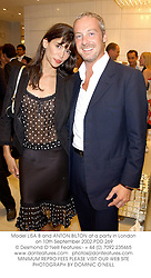 Model LISA B and ANTON BILTON at a party in London on 10th September 2002.PDD 269