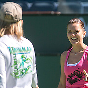 March 6, 2015, Indian Wells, California:<br /> Agnieszka Radwanska laughs with coach Martina Navratilova during a practice session on Stadium 1 at the Indian Wells Tennis Garden in Indian Wells, California Friday, March 6, 2015.<br /> (Photo by Billie Weiss/BNP Paribas Open)