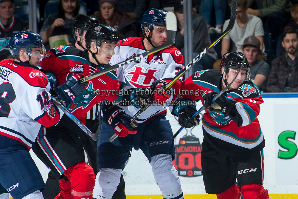 KELOWNA, CANADA - NOVEMBER 17: Ryan Vandervlis #21 of the Lethbridge Hurricanes is checked by Wil Kushniryk #14 and Cal Foote #25 of the Kelowna Rockets during second period on November 17, 2017 at Prospera Place in Kelowna, British Columbia, Canada.  (Photo by Marissa Baecker/Shoot the Breeze)  *** Local Caption ***