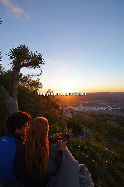Young couple enjoying a beautiful sunset from Mount Toro (Monte Toro), Menorca
