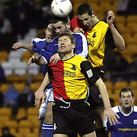 St Johnstone v Partick Thistle..22.01.05<br />Grant Murray and Adrian Madaschi defend from David Hannah and Peter MacDonald<br /><br />Picture by Graeme Hart.<br />Copyright Perthshire Picture Agency<br />Tel: 01738 623350  Mobile: 07990 594431