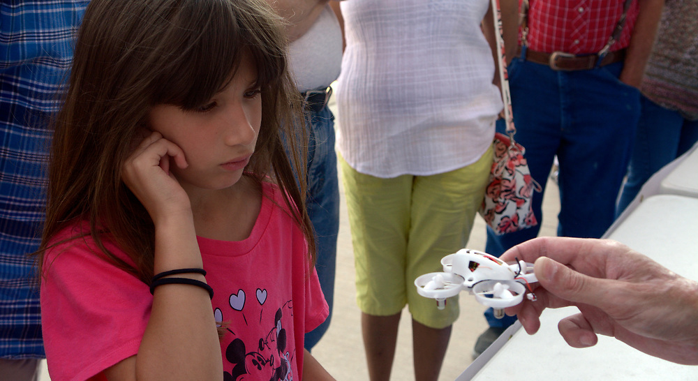 gbs062517l/ASEC - Jesse Sanson with Colibri Media House shows Korbyn Hays, 8, a micro drone, also known as a tiny whoop racer during the Drone Discovery Day at the Anderson Abruzzo Albuquerque International Balloon Museum on Sunday, June 25, 2017. (Greg Sorber/Albuquerque Journal)