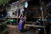 Oranuch Pholpinyo sits at a house in the village of Bo Kaew in Chaiyaphum Province. She is the Co-ordinator of the E-san Land Reform Network which assists people affected by issues concerning land and forest use, as well as industrial factories.