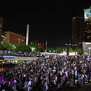 Wide angle shot of the Vitamin Water Stage crowd at 2008 Movement (Detroit Electronic Music Festival) with downtown Detroit buildings in the background.