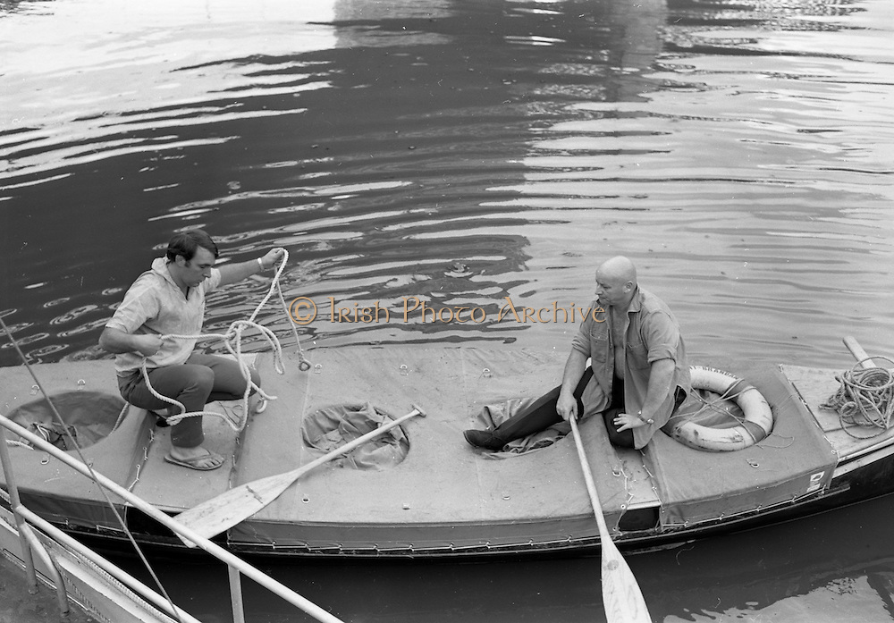 "03/08/1967<br /> 08/03/1967<br /> 03 August 1967<br /> Arrival of ""Saint Brendan II"" in Dublin. Image shows Captain Louis Lourmais and Vint Lloyd on board the ""Saint Brendan II"" a curragh they hoped to sail from Fenit Co. Kerry to America to see if Brendan the Navigator could have reached North America in the 6th century AD. The boat had just arrived in Dublin from Canada via Liverpool."