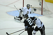 May 26, 2013; San Jose, CA, USA; San Jose Sharks left wing T.J. Galiardi (21) scores a goal against Los Angeles Kings goalie Jonathan Quick (32) during the second period in game six of the second round of the 2013 Stanley Cup Playoffs at HP Pavilion.