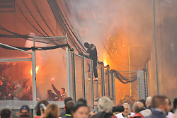 Serbian fans throw flares on the pitch during the UEFA EURO 2010 Group C qualifying match between Italy and Serbia was suspended at Luigi Ferraris Stadium on October 12, 2010 in Genoa, Italy.
