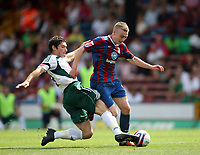 Palace's Freddie Sears, on loan from West Ham, is tackled by Plymouth's Jim Paterson<br /> Coca Cola Chmpionship. Crystal Palace v Plymouth. 08.08.09<br /> Pic By Karl Winter Fotosports International