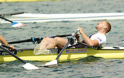 Munich, GERMANY, GBR M2X, bow Matt Wells,    collapses, exhausted,  after the final, 2006, FISA, Rowing, World Cup, on the Olympic Regatta Course, Munich,Sat.  27.05.2006. © Peter Spurrier/Intersport-images.com,  / Mobile +44 [0] 7973 819 551 / email images@intersport-images.com.[Mandatory Credit, Peter Spurier/ Intersport Images] Rowing Course, Olympic Regatta Rowing Course, Munich, GERMANY