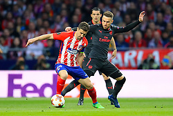 Atletico Madrid's Fernandez Gabi (left) and Arsenal's Aaron Ramsey battle for the ball during the UEFA Europa League, Semi Final, Second Leg at Wanda Metropolitano, Madrid.