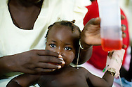 A young cholera patient is given an electrolyte solution at the Hospital Albert Schweitzer on Thursday, October 28, 2010 in Deschapelles, Haiti.